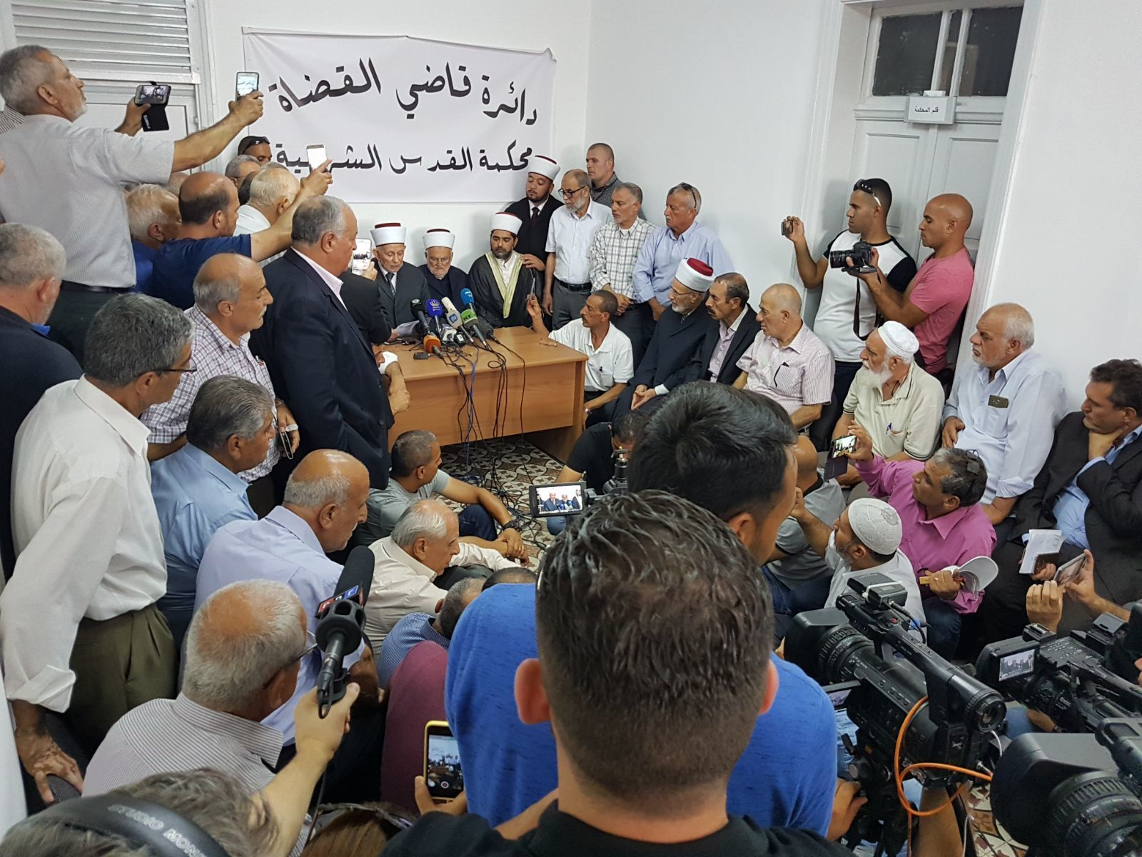 Muslim leaders announce the Muslim return to pray at Temple Mount, July 27, 2017.