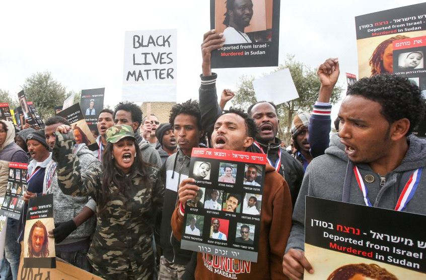 Sudanese and Eritrean immigrants protest their treatment in front of the Knesset. (MARC ISRAEL SELLEM)