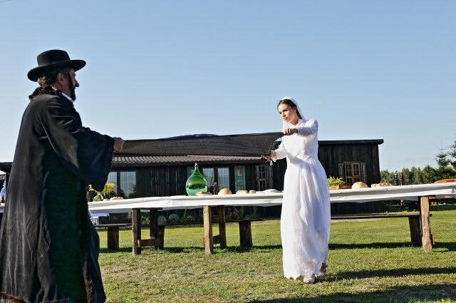 The 'bride' rejoices at the Jewish wedding recreation in Radzanow. (credit: JONNY DANIELS)