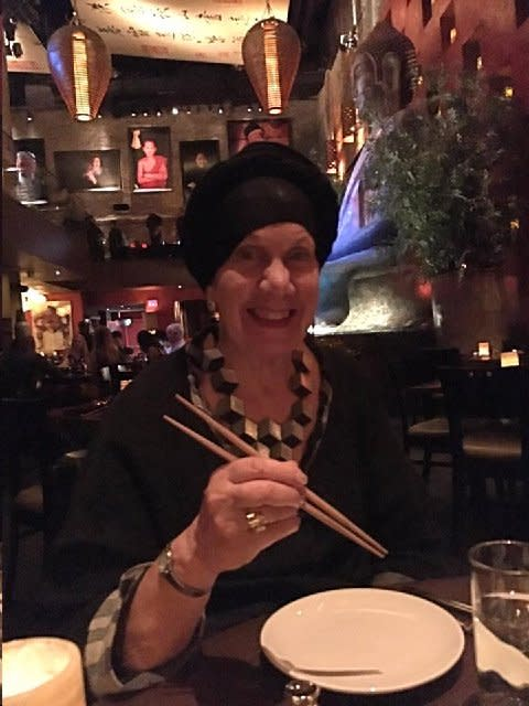 Rabbi Yocheved Mintz after procedure enjoying dinner with chopsticks (AMERICAN FRIENDS OF RAMBAM)