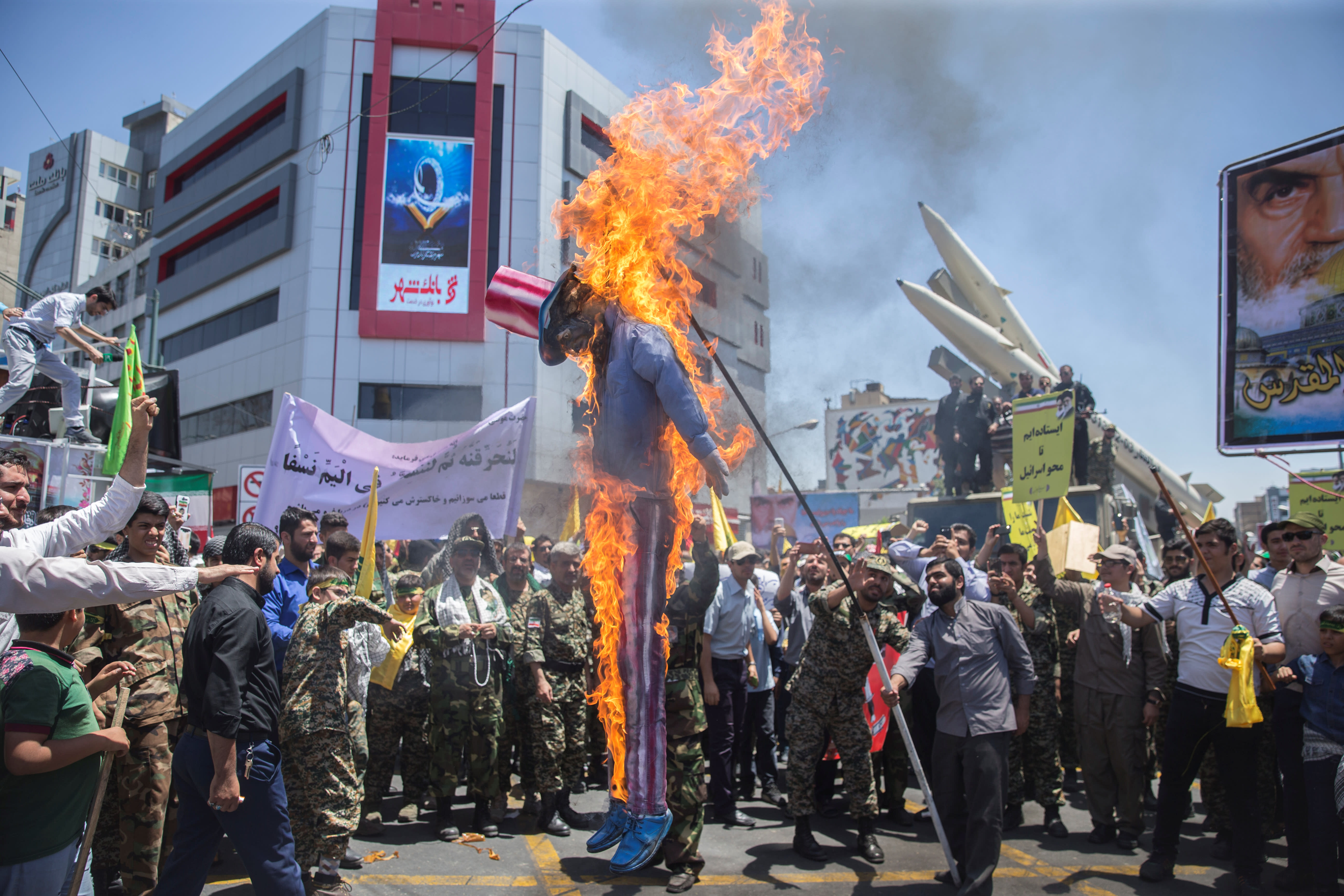 A scarecrow model is set on fire by Iranian demonstratorson during the annual pro-Palestinian rally marking Al-Quds Day in Tehran, Iran, June 23, 2017. (NAZANIN TABATABAEE YAZDI/ TIMA VIA REUTERS)