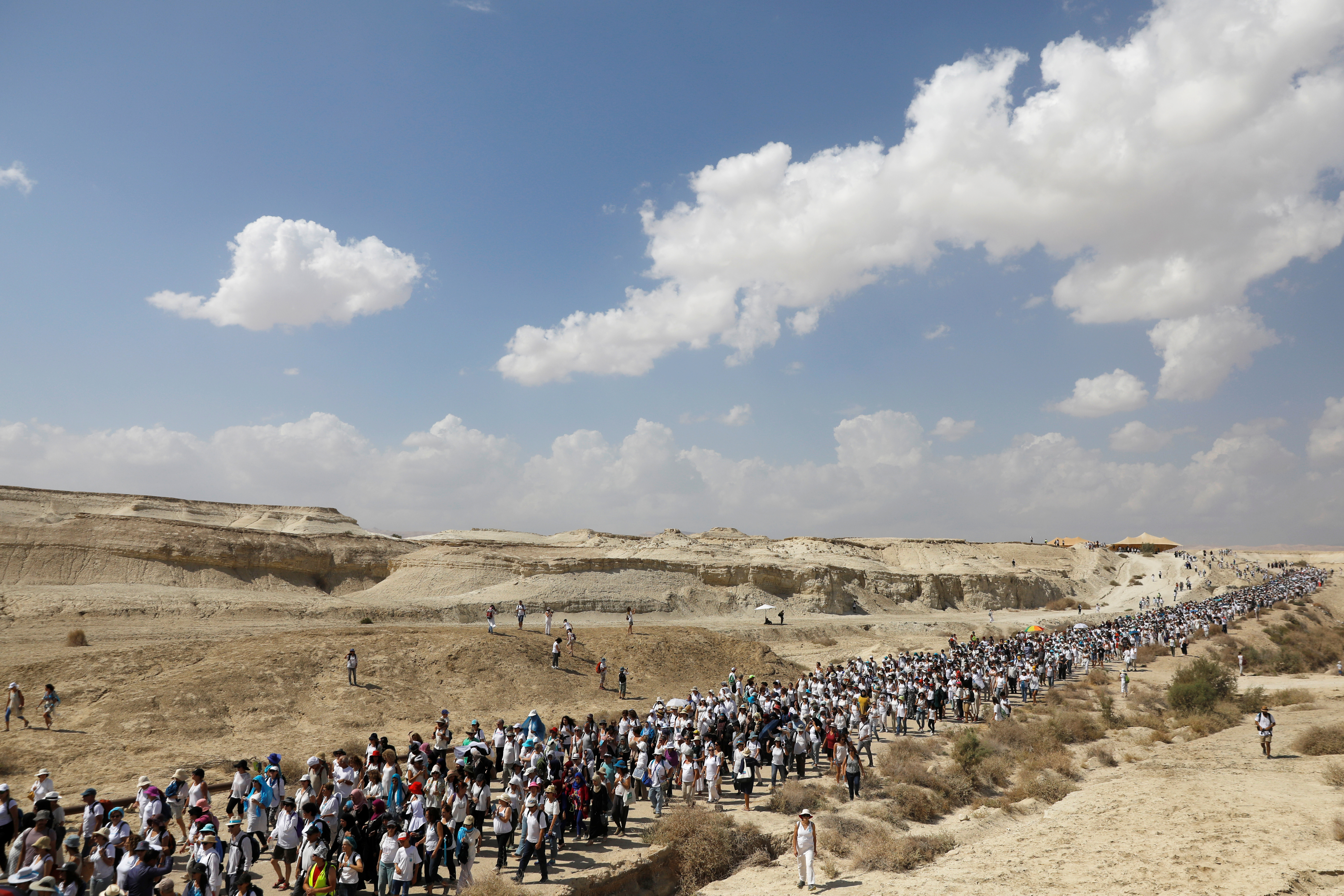 """Palestinian and Israeli women march, as part of an event organised by """"Women Wage Peace"""" group calling for an end to the Israeli-Palestinian conflict, near the Jordan River, in the West Bank October 8, 2017."""