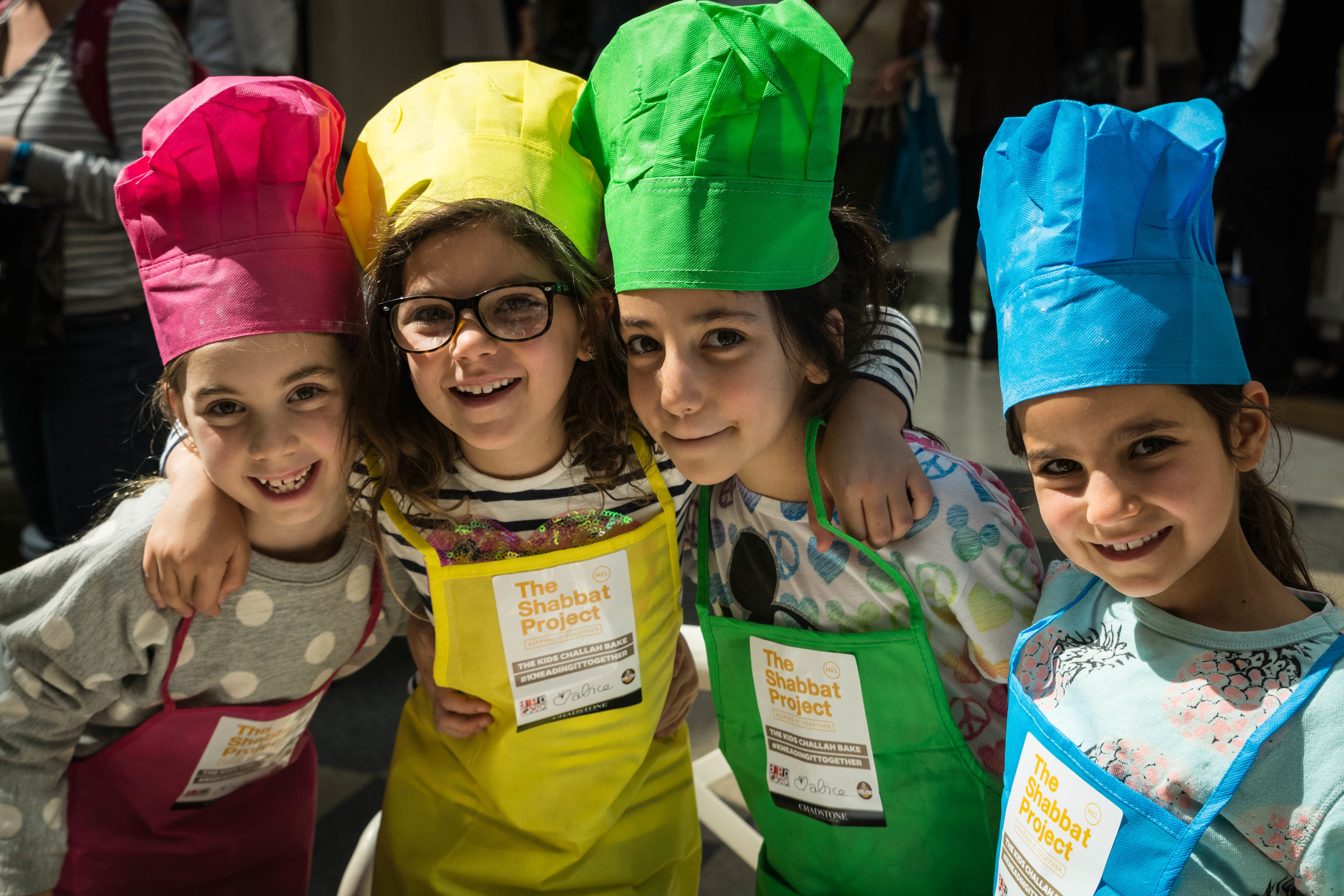 Girls in Melbourne bake challahs during The Shabbat Project (The Shabbat Project)