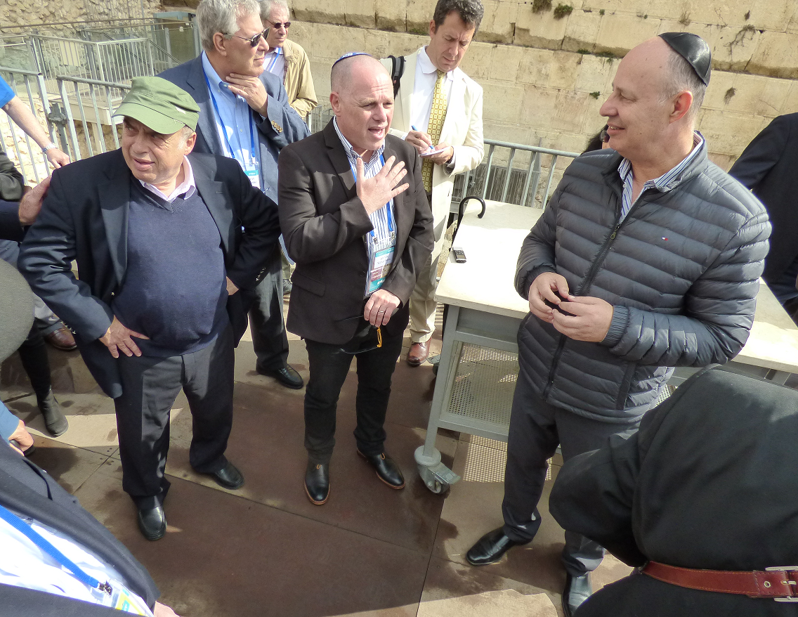 Jewish Agency Chairman Natan Sharansky and Minister Tzachi Hanegbi speak to members of the Jewish Agency Board of Governors at the egalitarian section of the Western Wall, October 30, 2017. Photo credit: David Shechter for The Jewish Agency for Israel.