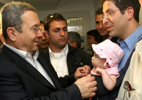 "Former Prime Minister Ehud Barak tells baby in 2007 that she will vote for him when he is ""Shimon's (Peres) age"" (ARIEL JEROZOLIMSKI)"