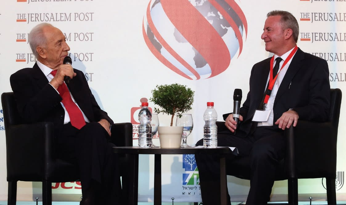 SHIMON PERES with Steve Linde at the Jerusalem Post Diplomatic Conference in Herzliya in 2013. (Marc Israel Sellem)