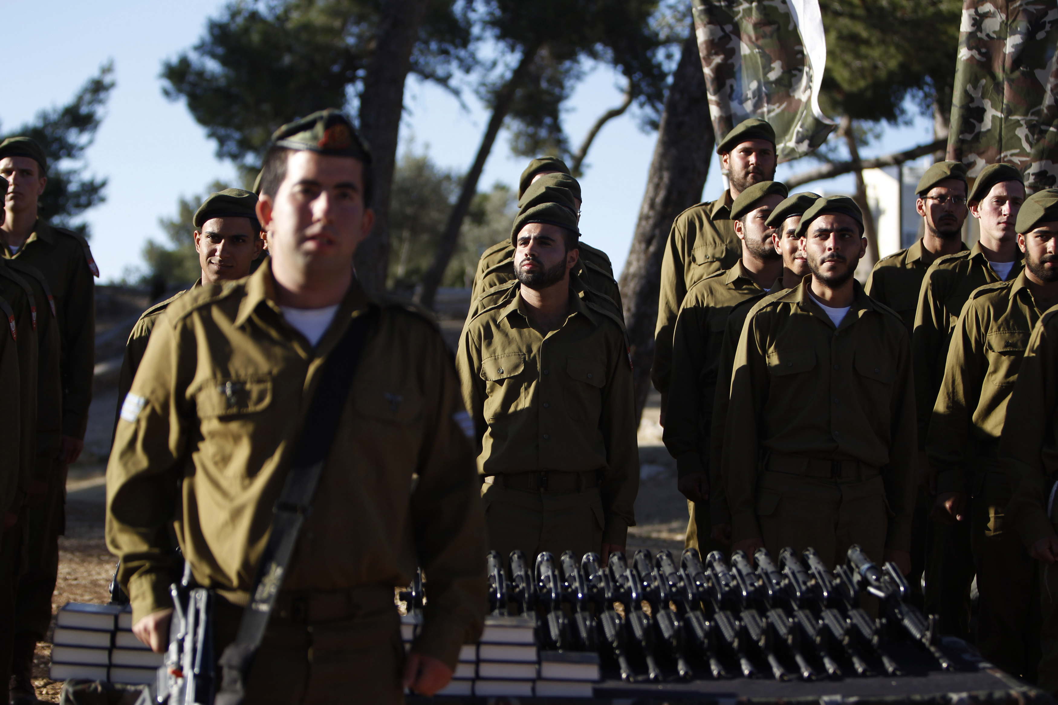 Israeli soldiers of the Ultra-Orthodox brigade take part in a swearing-in ceremony in Jerusalem. (Ammar Awad/REUTERS)