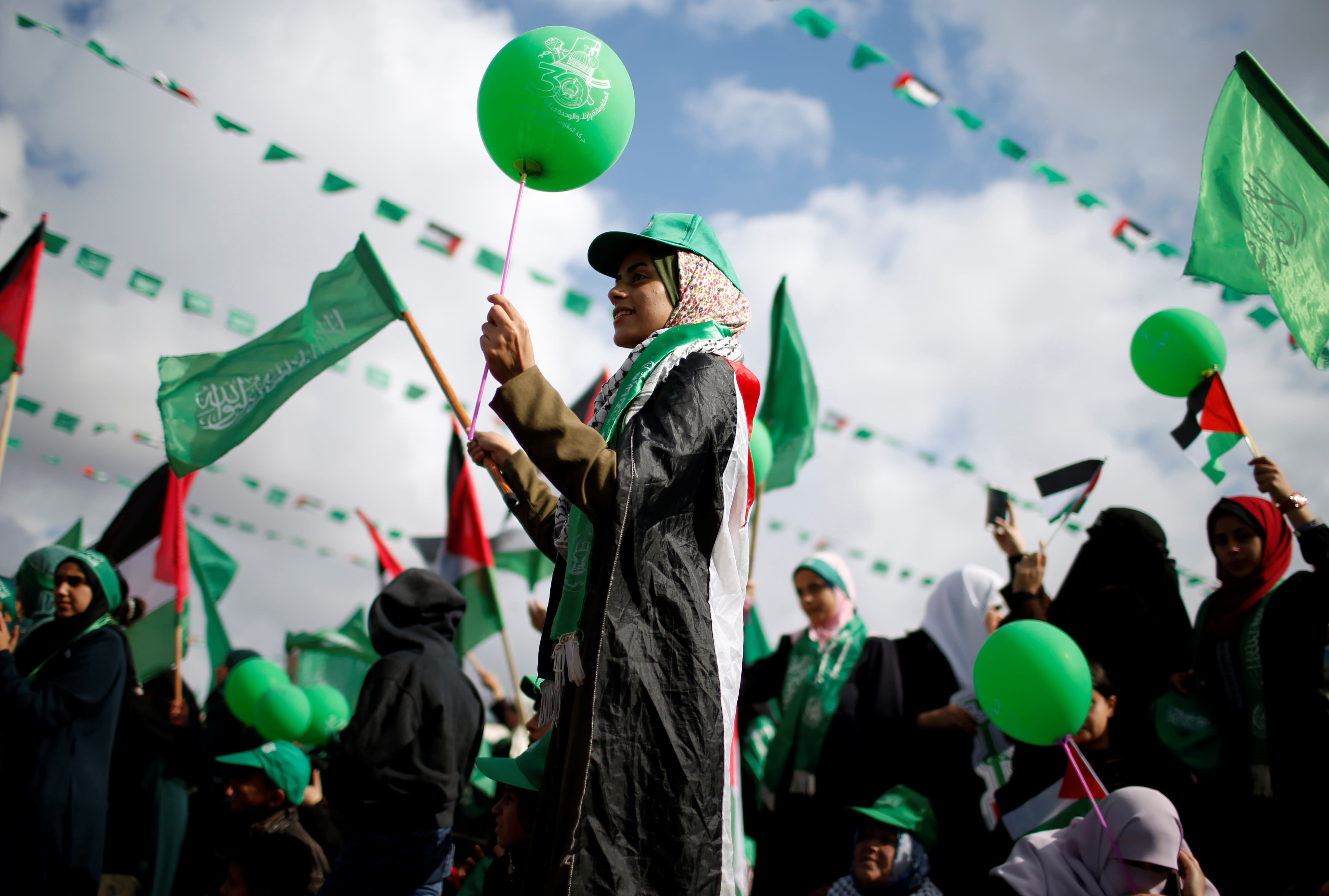 Palestinians supporting Hamas take part in a rally marking the 30th anniversary of Hamas' founding in Gaza City, December 14, 2017 (MOHAMMED SALEM/REUTERS)
