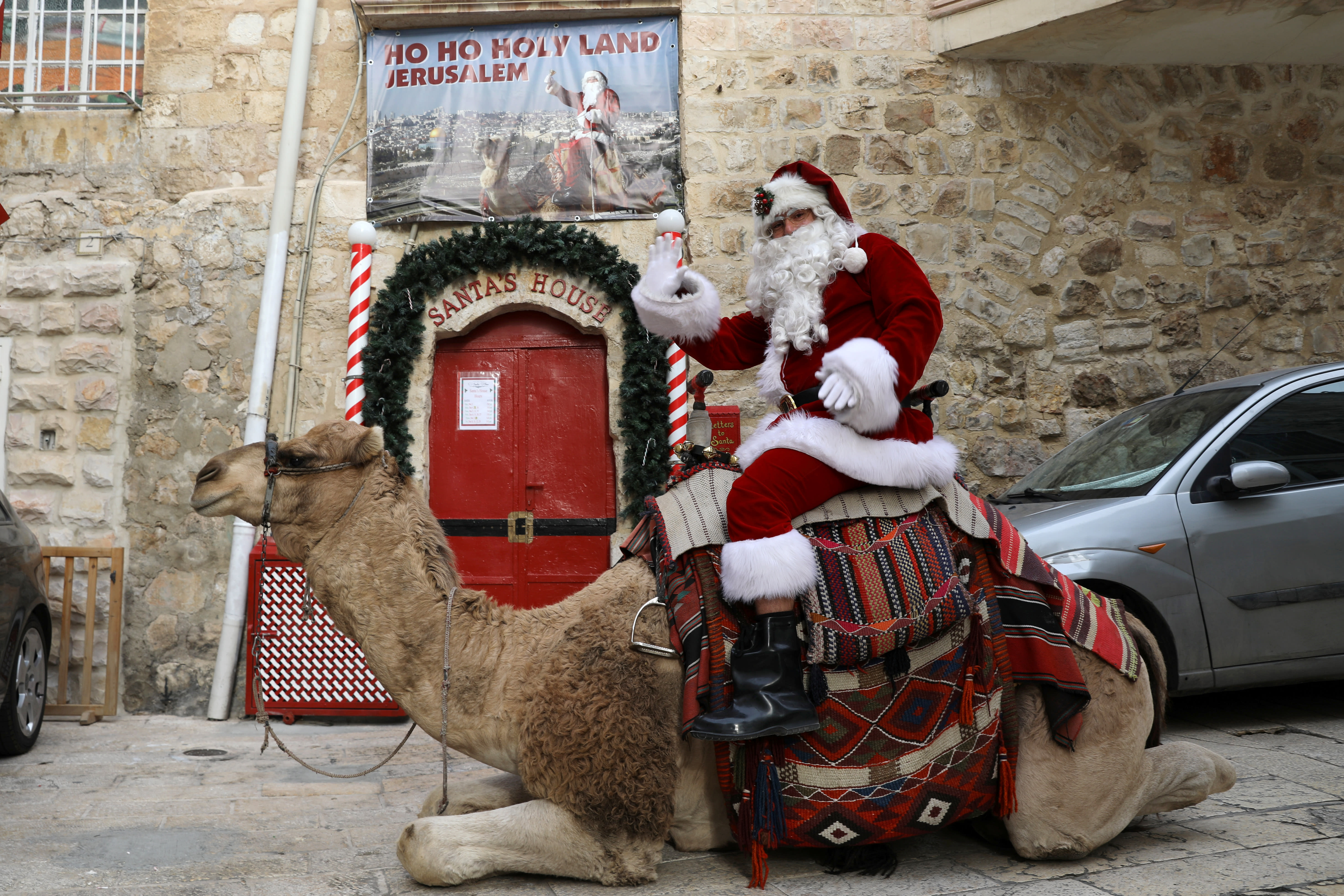Camel-riding Santa Offers Free Christmas Trees To
