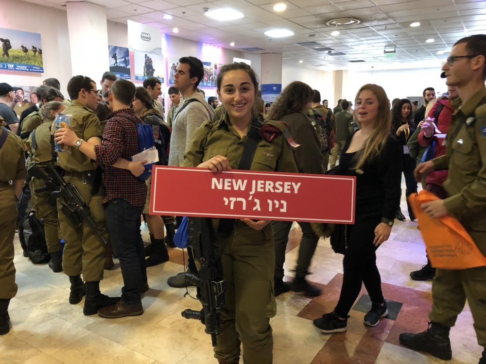 """Lone soldier Alexis Wasserman attends """"errands day."""" (ANNA AHRONHEIM)"""