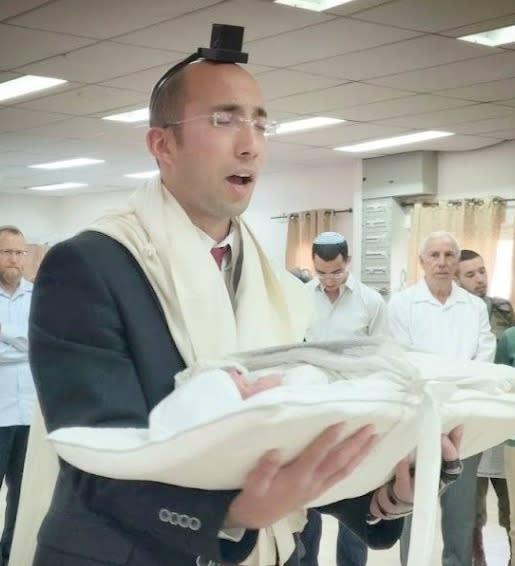 The victim Itamar Ben Gal at his son's bris a year and a half ago (COURTESY SAMARIA REGIONAL COUNCIL)
