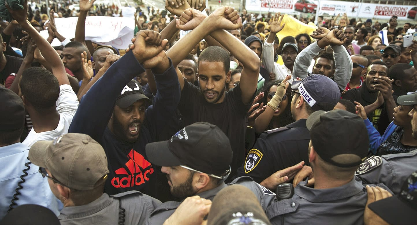Israelis, mainly of Ethiopian origin, shout slogans in 2015 during a demonstration in Tel Aviv against police racism and brutality, a day after mounted police charged hundreds of Ethiopian-Israelis and fired stun grenades to clear a violent protest there. (Baz Ratner/Reuters)