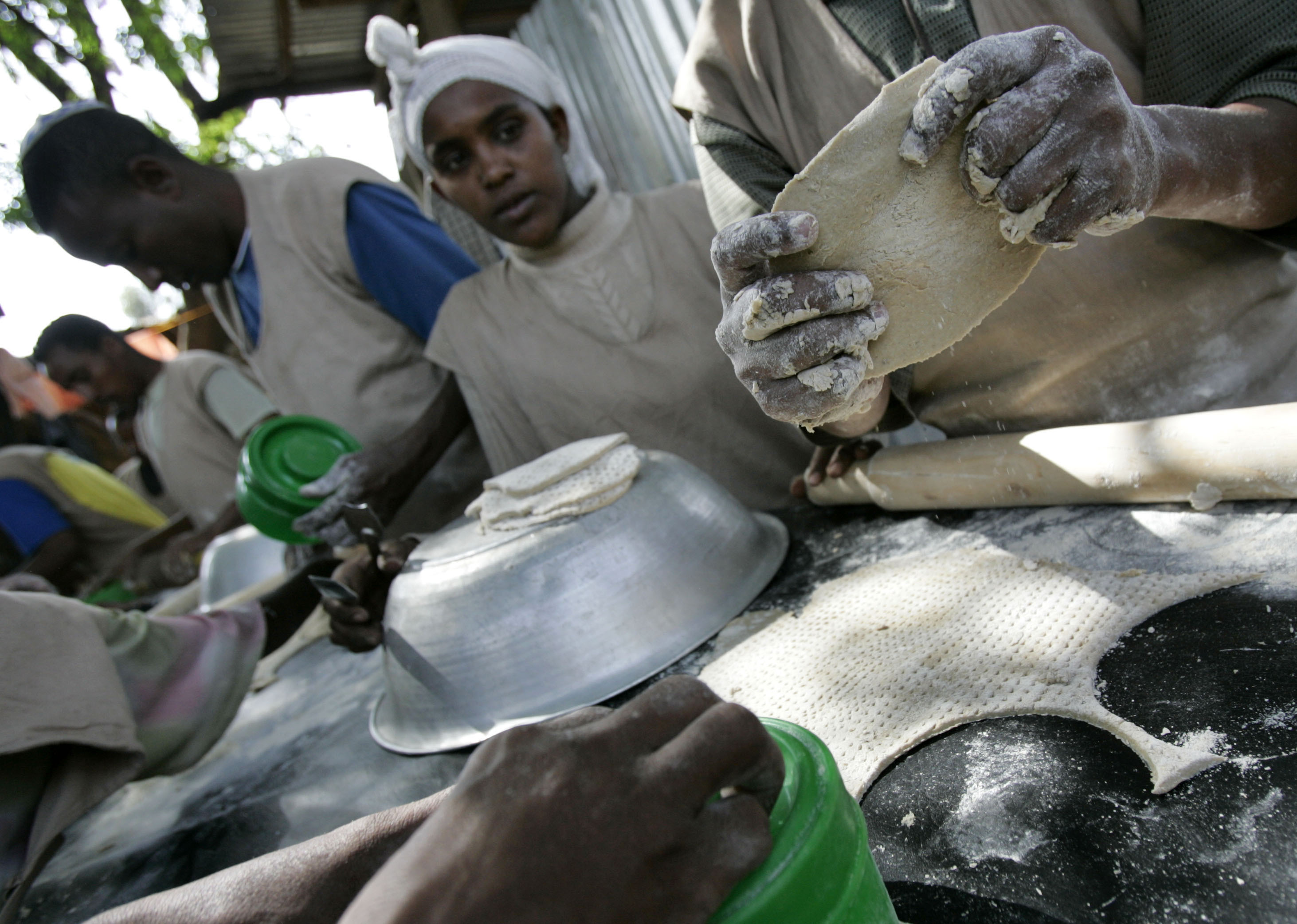 Jewish Ethiopians make matzah in preparation for Passover at a compound while awaiting immigration to Israel in Gondar March 9, 2007 (ELIANA APONTE/REUTERS).