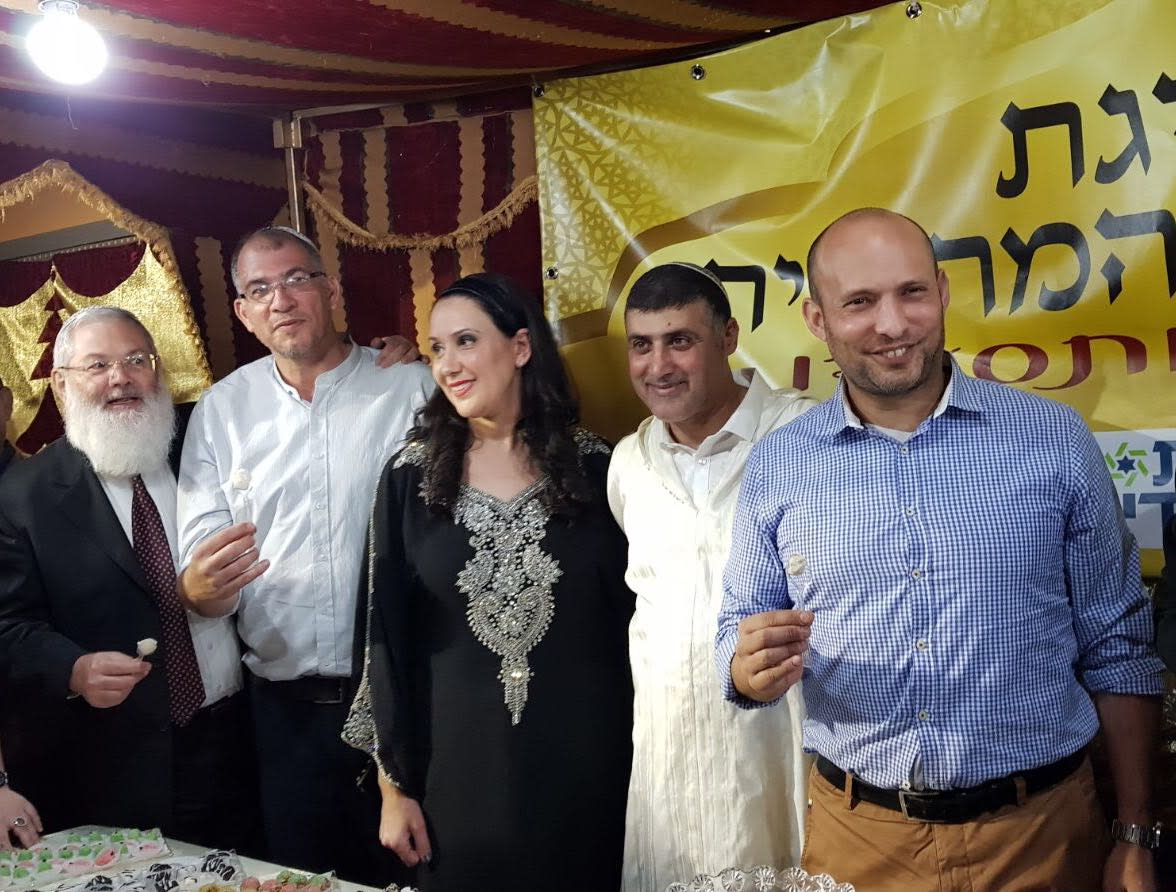 MK and Education Minister Naftali Bennett at the Mimouna hosted by the Harosh family in Lod, April 2018 (Courtesy)