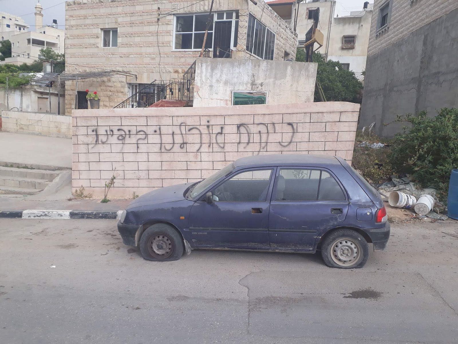 "'Price tag' attack: ""Let's take our fate into our own hands"" spray-painted on a stone wall in the village of Dir Ammar in the Binyamin district (COURTESY POLICE SPOKESMAN'S UNIT)"