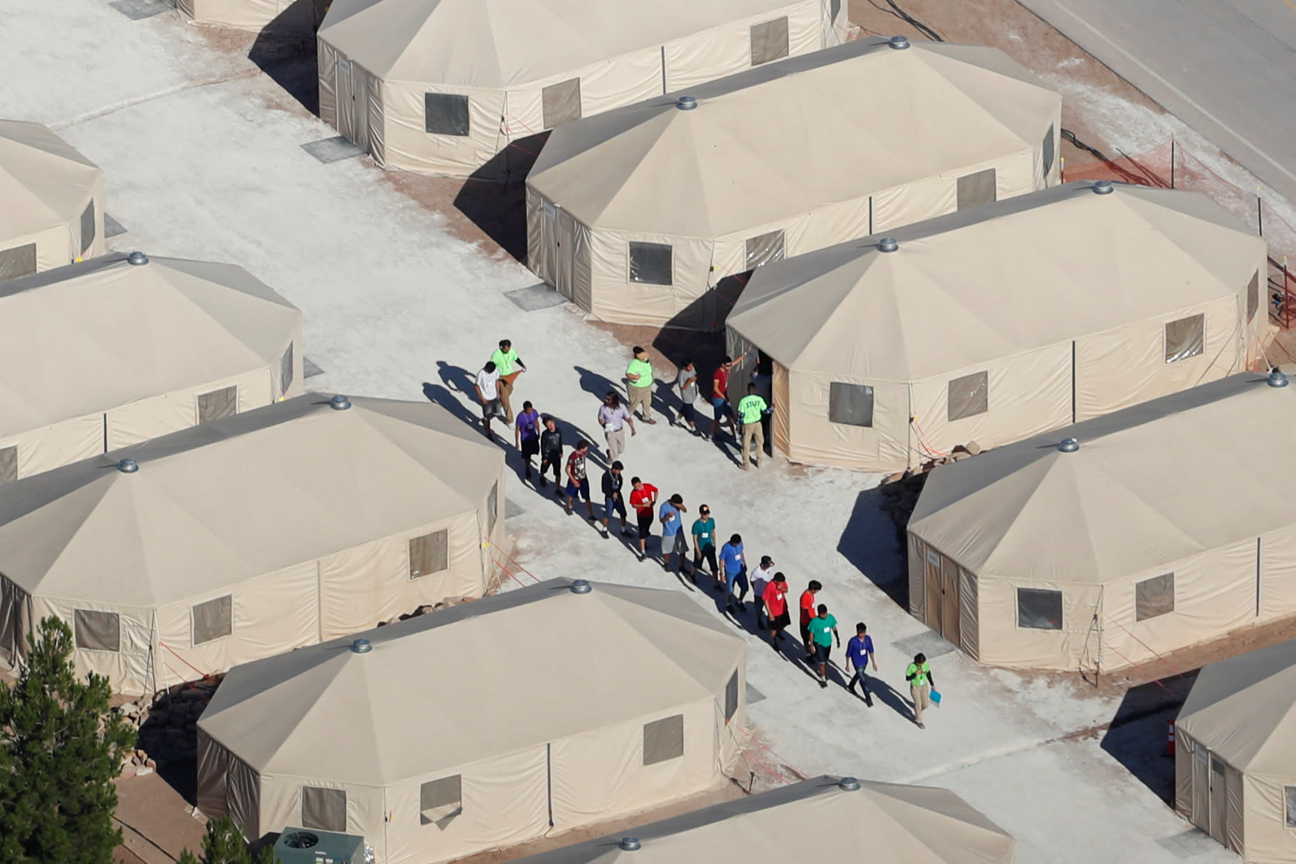 "Immigrant children, many of whom have been separated from their parents under a new ""zero tolerance"" policy by the Trump administration, are being housed in tents next to the Mexican border in Tornillo, Texas, U.S. June 18, 2018. (REUTERS/Mike Blake)"