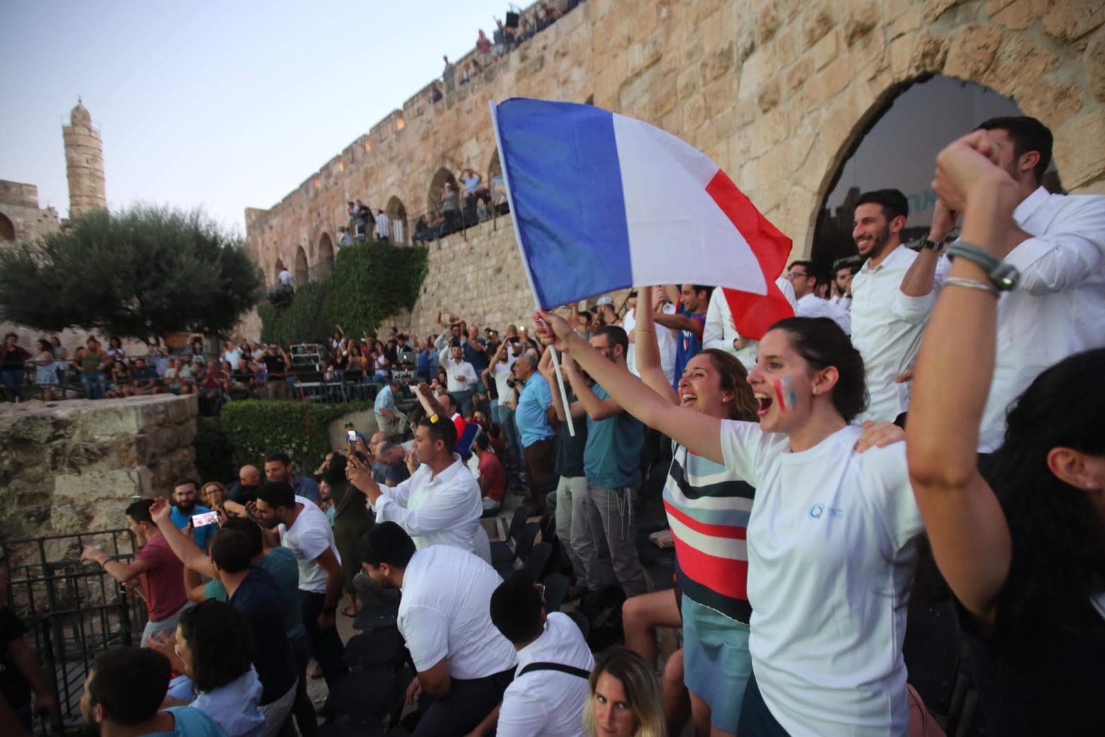 French soccer fans celebrate France's 4 - 2 win over Croatia outside the Old City of Jerusalem (MARC ISRAEL SELLEM)