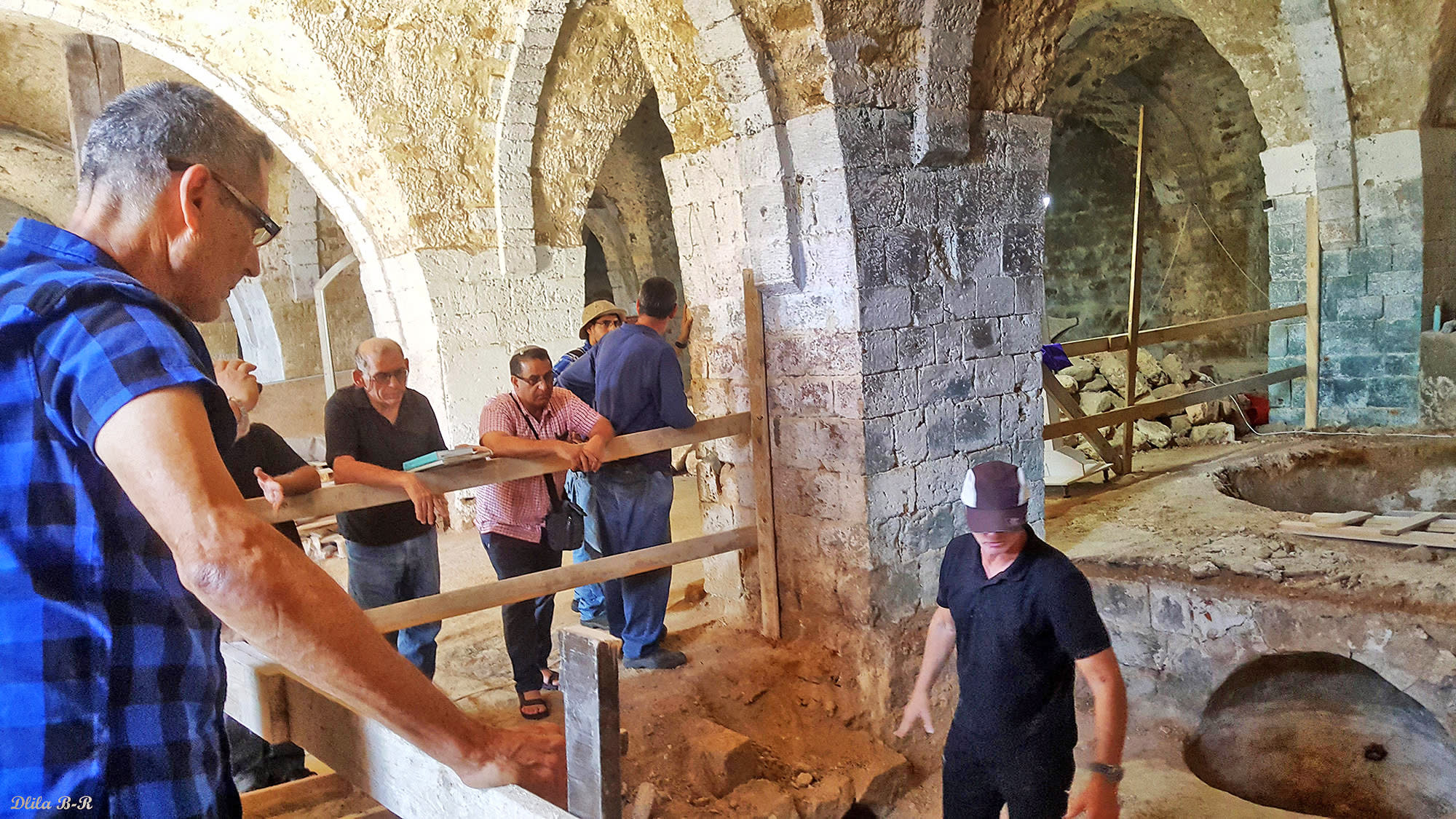 Dr. Yoav Arbel of the Israel Antiquities Authority, explains Geller how soap was manufactured in the 19th century. (Dlila Bar-Ratson)