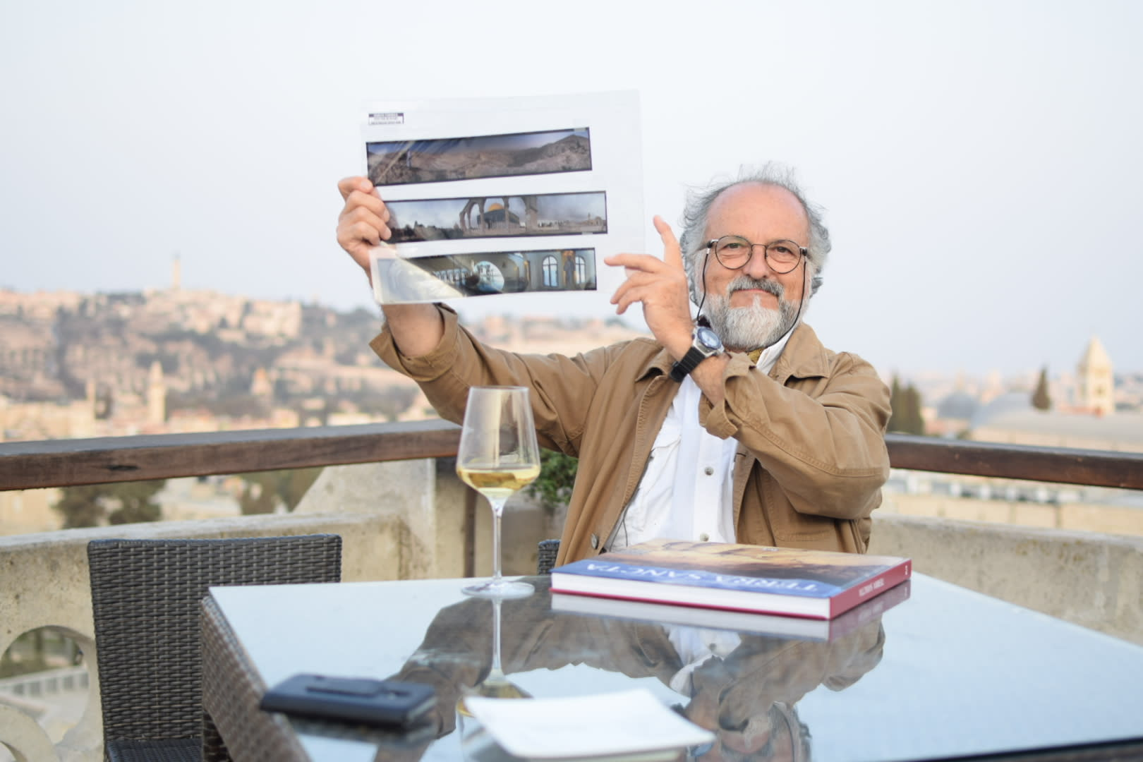 "Photographer Enrico Formica presents his new book ""Terra Sancta"", published in honor of the 130th anniversary of the Notre Dame piligrim center in Jerusalem September 13, 2018 (Juliane Helmhold)"
