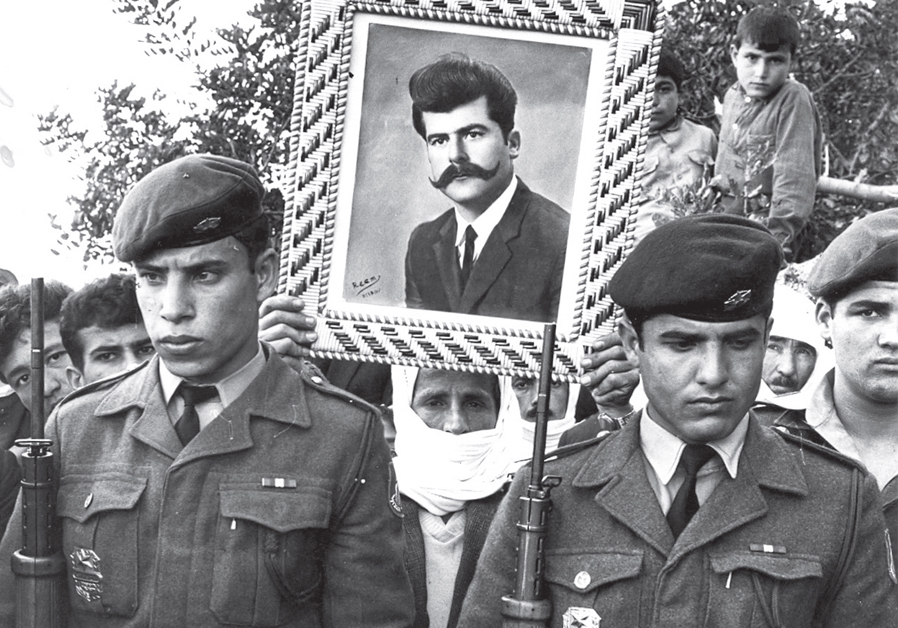 A DRUZE frontier force policeman (pictured in the photograph), killed in active service on the West Bank, is buried in his Western Galilee home village around 1980. (MICHA BAR-AM)