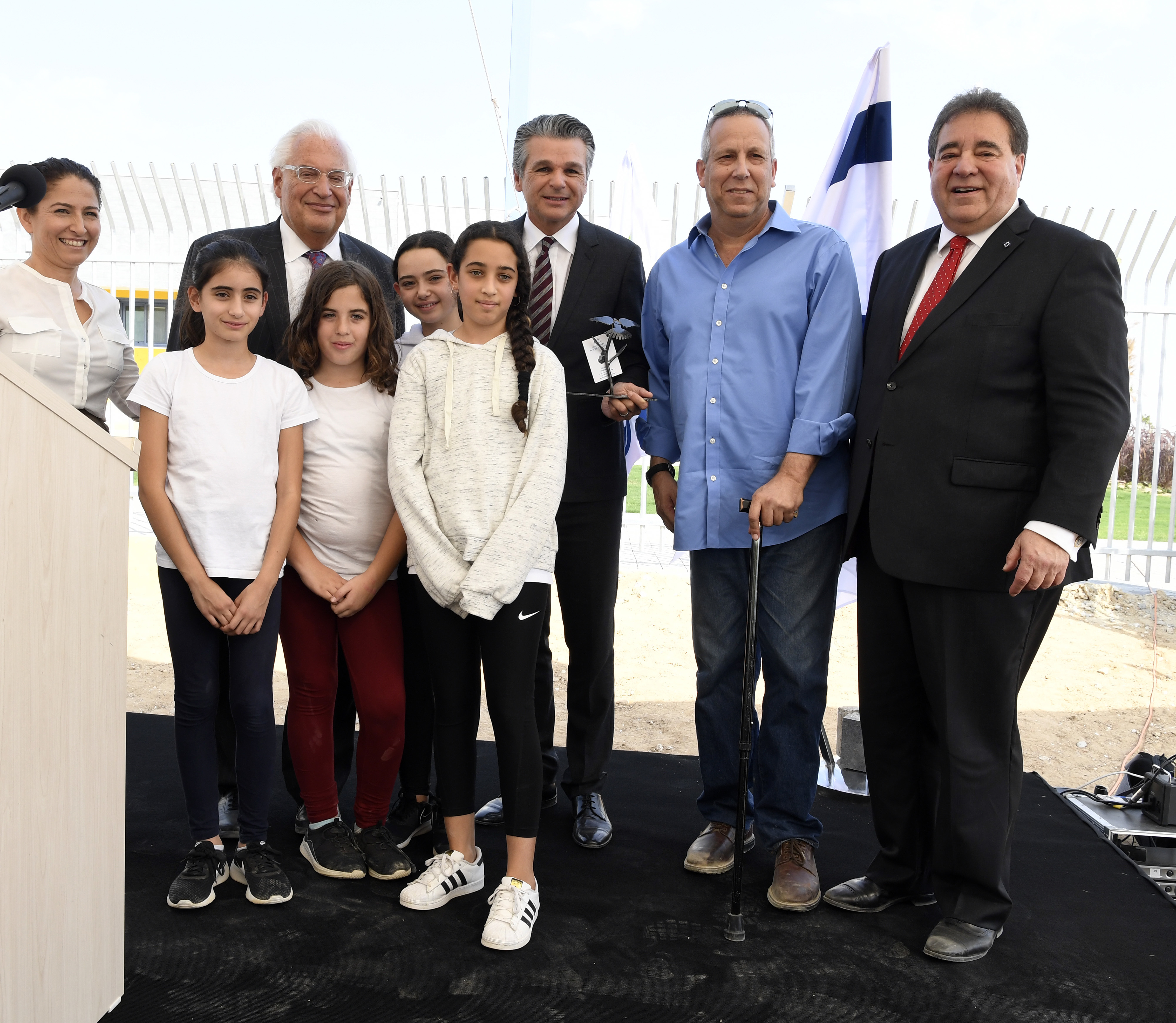 Michal Uziyahu, Eshkol Director of Community Centers, Ambassador David Friedman, Pastor Jentezen Franklin, Eshkol Mayor Gadi Yarkoni, and JNF-USA CEO Russell Robinson join children from the Eshkol region in dedicating the new Playschool. (Credit: JNF-USA)