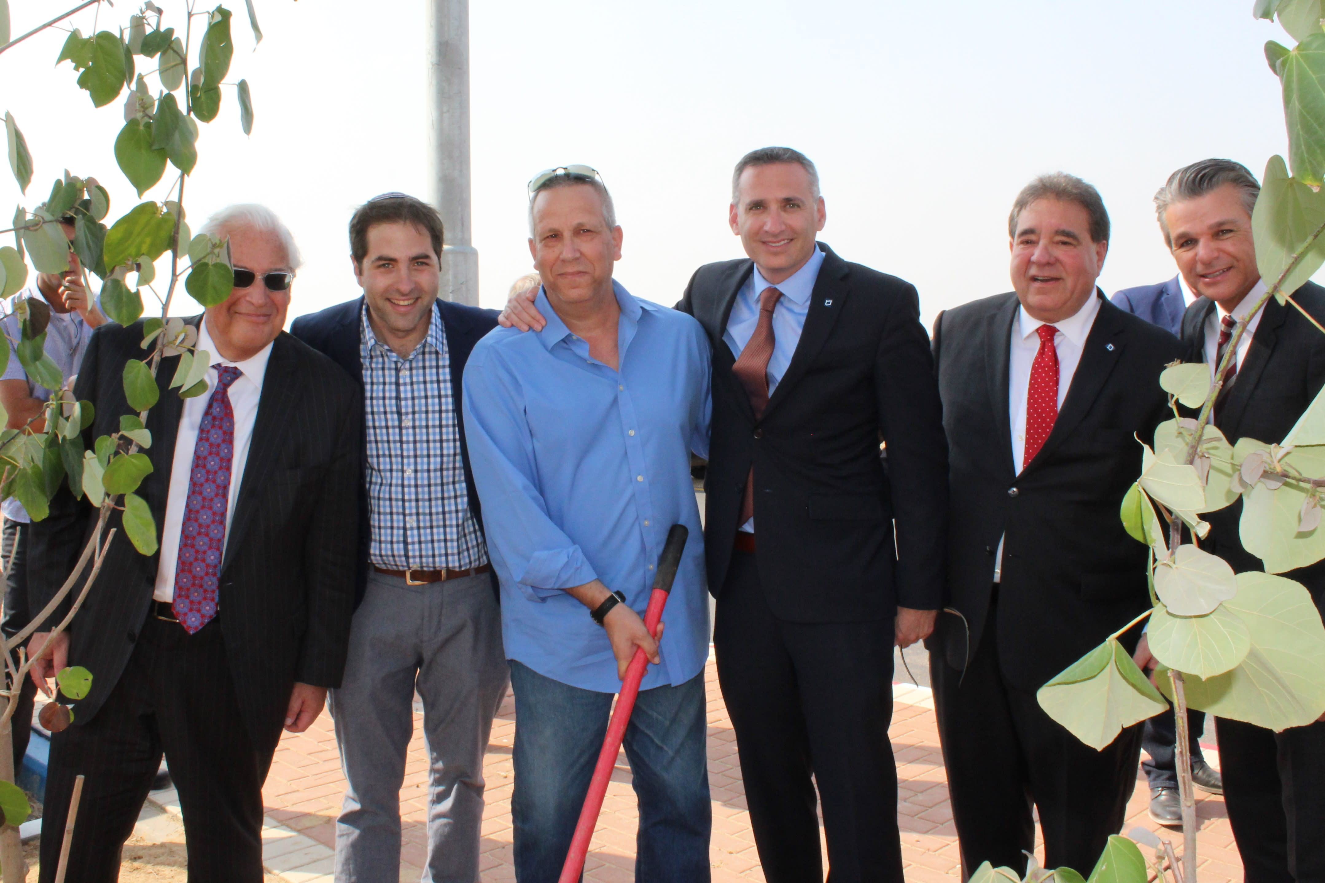 US Ambassador David Friedman, JNF Project Coordinator Yoel Rosby, Eshkol Mayor Gadi Yarkoni, JNF Chief Israel Officer Eric Michaelson, JNF CEO Russell Robinson and Pastor Jentezen Franklin plant trees outside the new Playschool, symbolic of the strength and growth of the Eshkol community. (Credit: JNF-USA)
