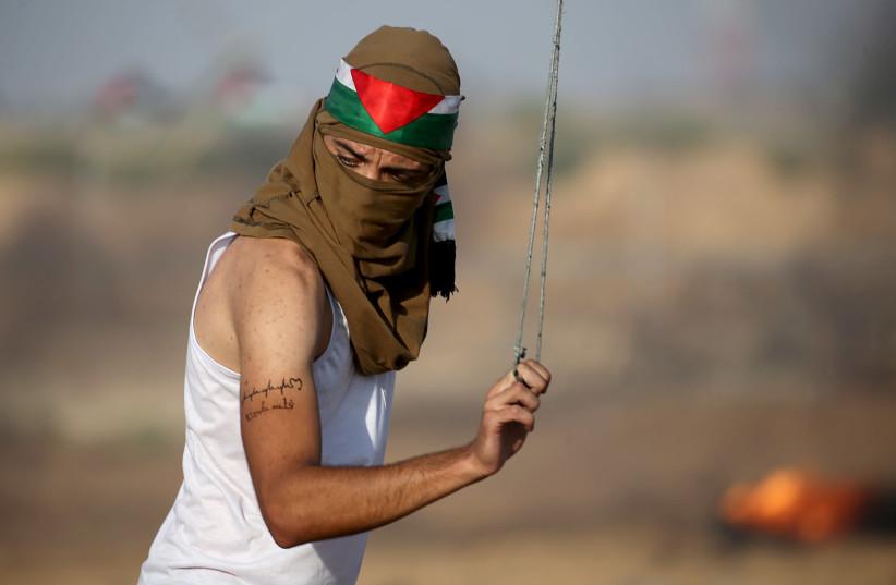 Thousands of Palestinians protest at the Gaza Strip border, 37 injured - Jerusalem Post