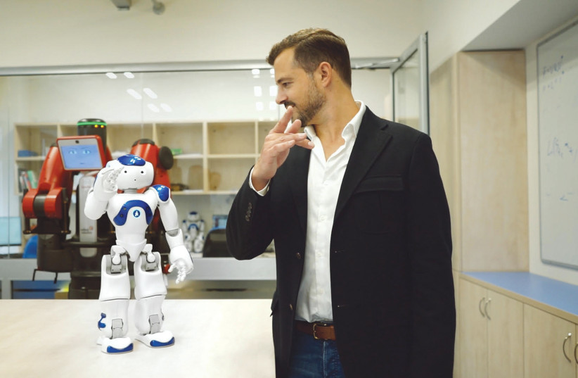 AI ROBOT Nao teaches 'TechTalk' host and executive producer Jonny Caplan how to do Tai Chi in the Curios Robots Lab at Tel Aviv University (photo credit: Courtesy)
