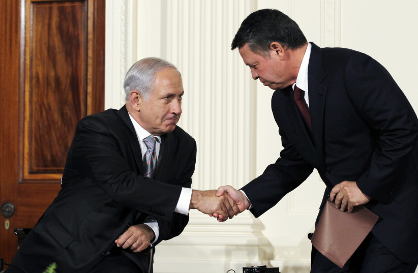 Jordan's King Abdullah II (R) greets Israeli Prime Minister Benjamin Netanyahu, as leaders gathered to deliver a joint statement on Middle East Peace talks in the East Room of the White House in Washington September 1, 2010 (photo credit: REUTERS/JASON REED)