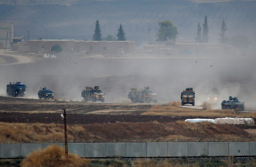 Turkish and Russian military vehicles return following a joint patrol in northeast Syria, as they are pictured near the Turkish border town of Kiziltepe in Mardin province, Turkey, November 1, 2019 (photo credit: REUTERS/KEMAL ASLAN)