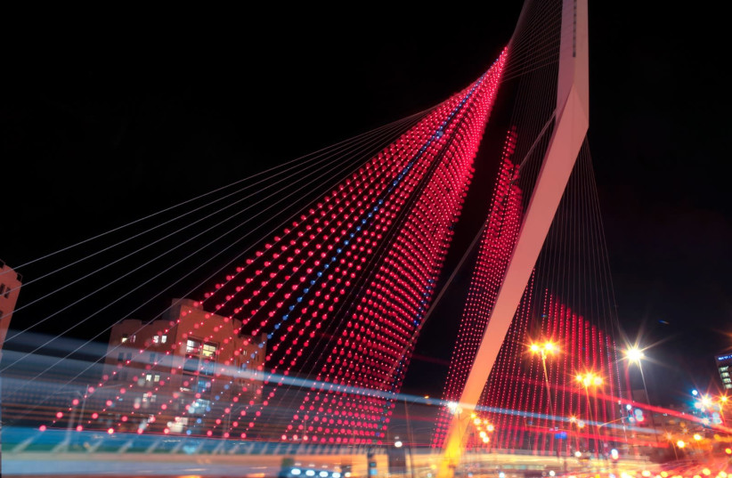 Chords Bridge in Jerusalem is lit in red to mark the need to fight violence against women  (photo credit: TAMIR HAION)