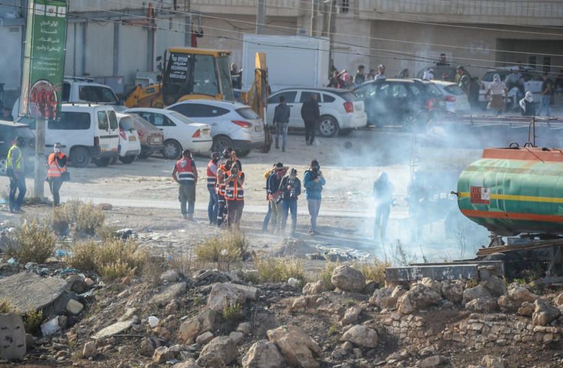 Palestinian protesters during the Day of Rage near Ramallah on Tuesday November 26 2019  (photo credit: KOBI RICHTER/TPS)