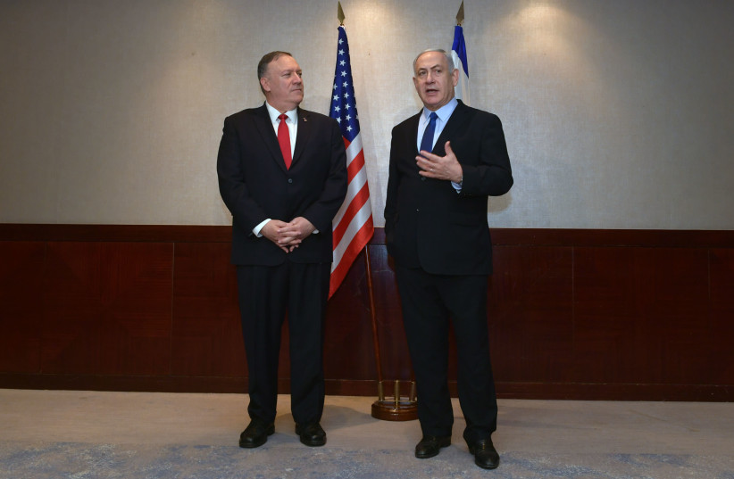 US Secretary of State Mike Pompeo and Prime Minister Benjamin Netanyahu meet in Lisbon, December 4, 2019 (photo credit: KOBI GIDEON/GPO)
