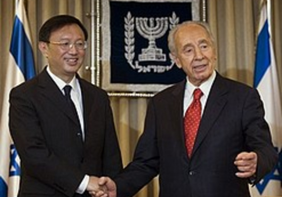 Peres: 'China has large role in stopping Iran'