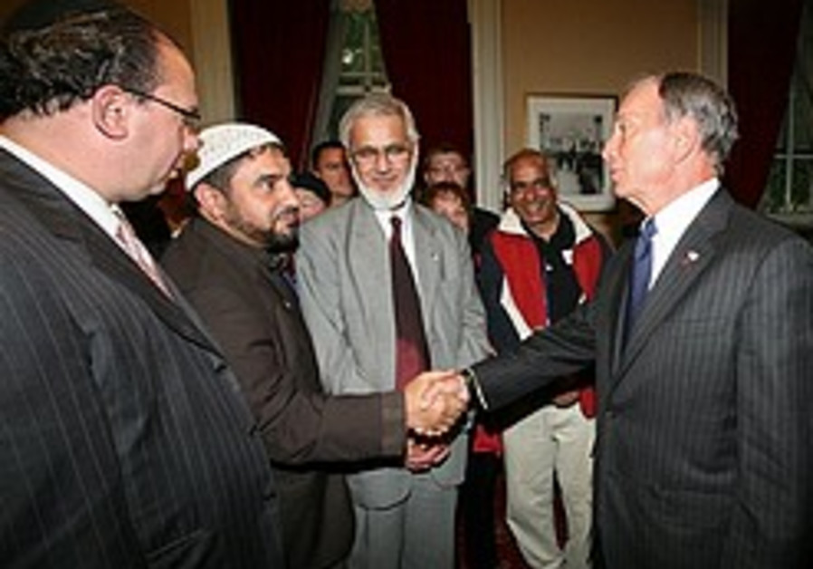 New York City Mayor Michael Bloomberg, right, gree