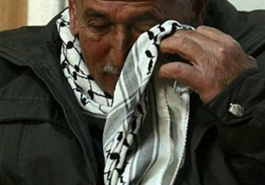 Palestinians mourn for Saddam
