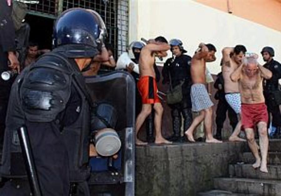 Prison riot in El Salvador leaves at least 20 dead