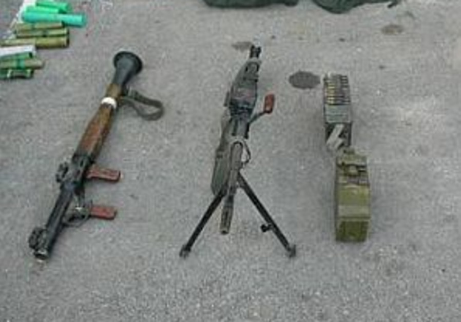4 charged with smuggling arms
