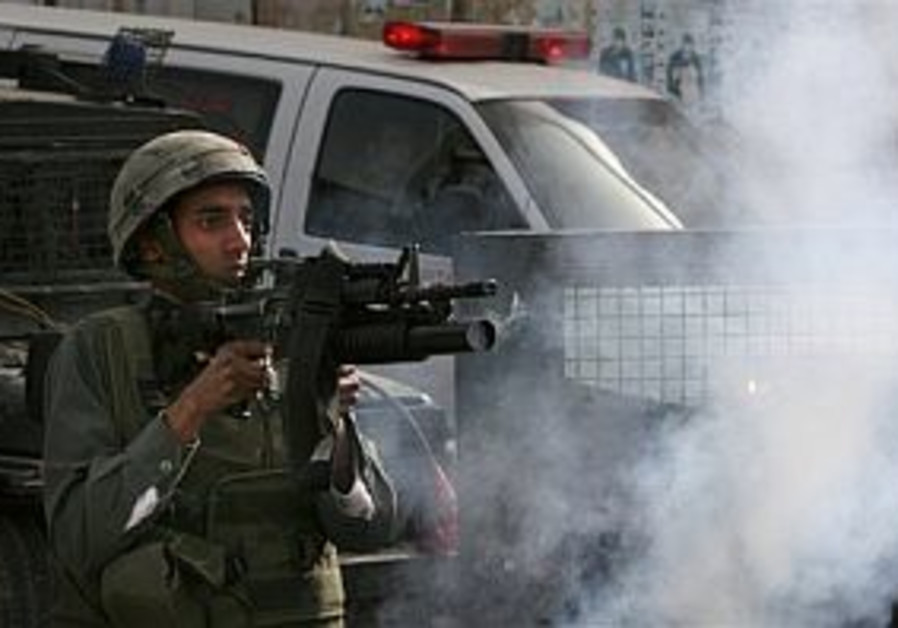 Palestinians shoot at two IDF outposts