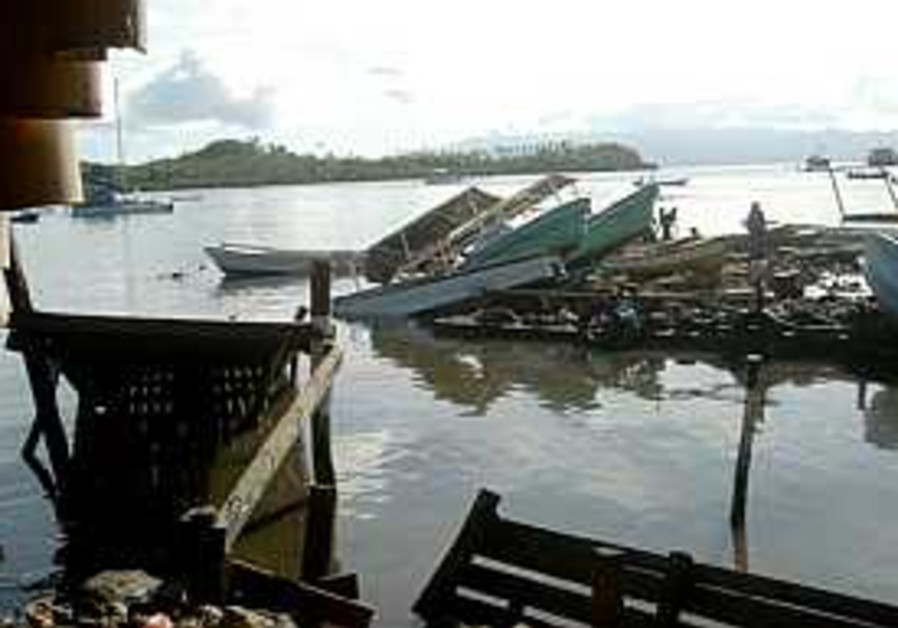 Death toll of tsunami disaster nears 30