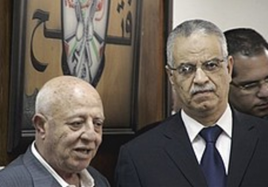 Fatah official Ahmed Qurei with Mohammed Ibrahim,