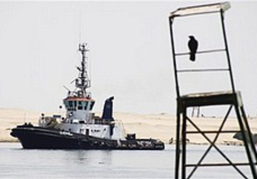An Egyptian Suez canal pilot boat sails at the can