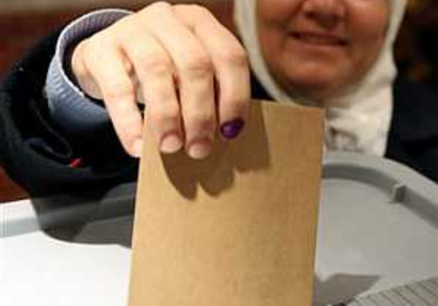 Syrians vote for new parliament; critics call election farce