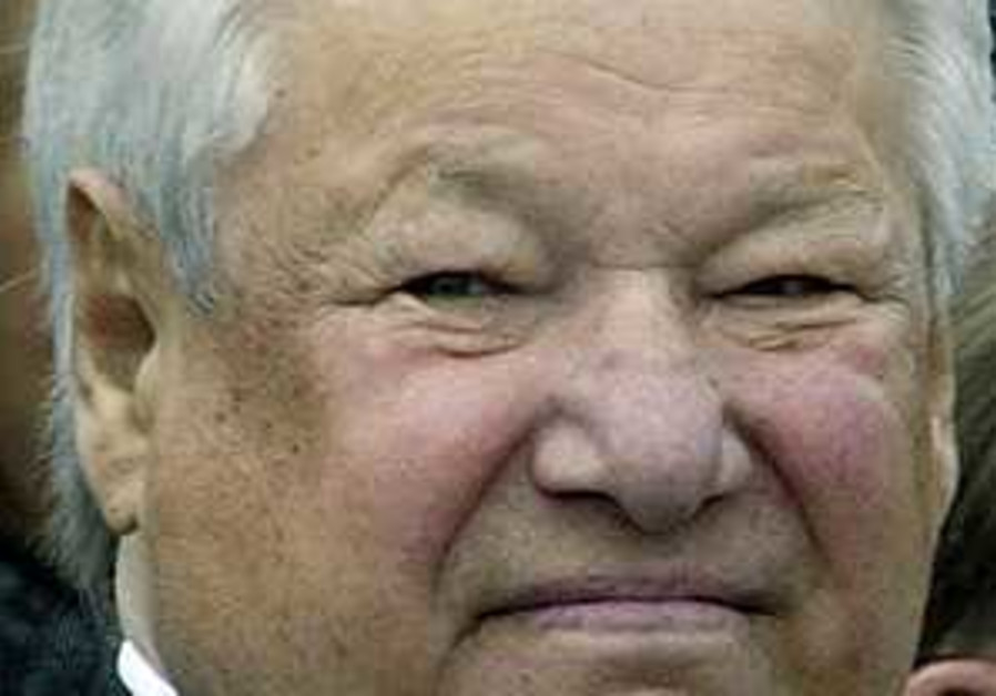 Russia bids farewell to Yeltsin as mourners file past casket