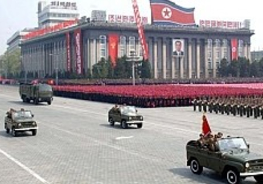 'N. Korea loading rocket on launch pad'