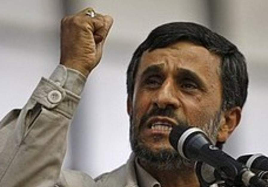Ahmadinejad speaks during an election campaign eve