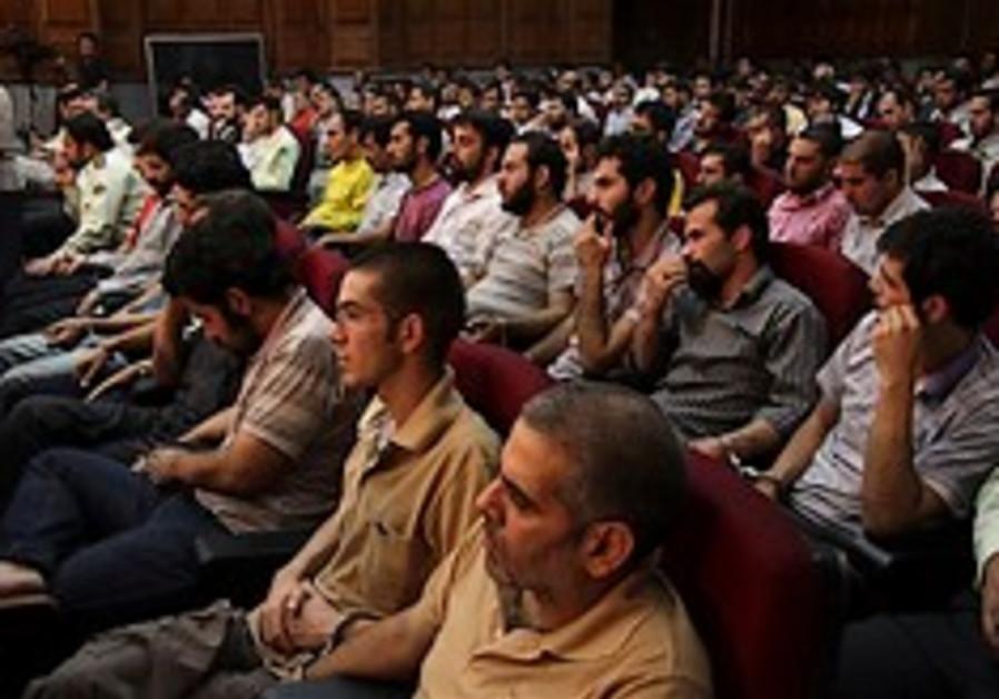 Defendants sit at a court room in Teheran, Iran, S