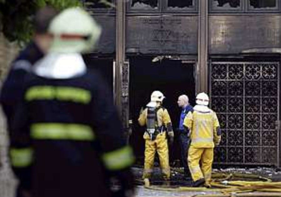 Swiss synagogue on edge awaiting results of fire probe