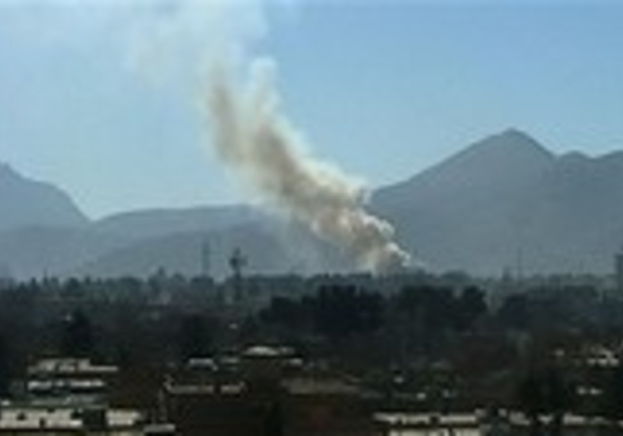 Smoke rise over Kabul Monday, after explosions roc