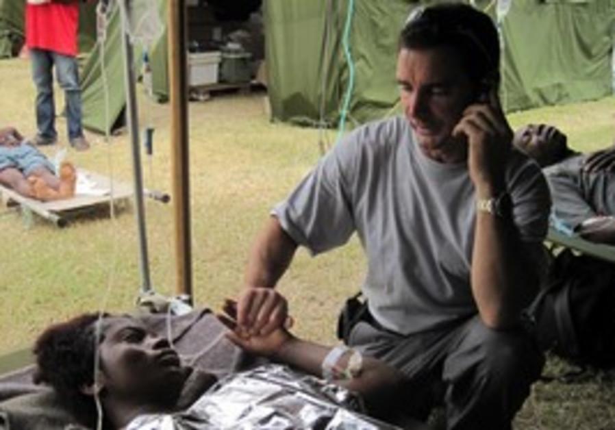 Daniel Kedar squeezes at the IDF hospital the hand